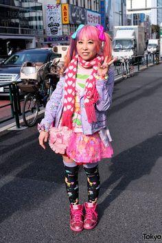 Suiya, singer for Japanese oshare-kei band DecoLa Hopping!   Layered tops, various brands; Milklim jacket. Layered tulle skirt, graphic socks, metallic red sneakers. Accessories: hair bows & bracelets 6%DOKIDOKI, heart-print scarf, lace heart purse, Tokyo Disneyland anniversary tote bag.