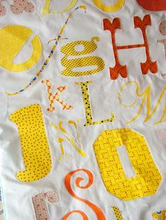 Print out letters with different fonts, trace on fabric and sew on quilt!