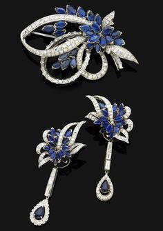 A suite of sapphire and diamond jewellery  Comprising a brooch, modelled as a floral cluster of navette-shaped sapphires with pavé-set diamond leaves, to the brilliant and baguette-cut diamond ribbon detail, detachable pendent earrings en suite, mounted in 18 carat white gold, brooch width 5.8cm, diamonds appoximately 6.00 carats total, sapphires approximately 7.00 carats total, brooch width 6.5cm, earring length 6.0cm