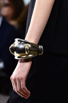 Oversized cuffs at Giambattista Valli  For his Fall/Winter 2013-2014 show, Giambattista Valli chose not to accessorize his first looks out, which were marked by their clean lines and sober cuts, but he embellished his evening gowns with a pair of XXL raw metal cuffs.