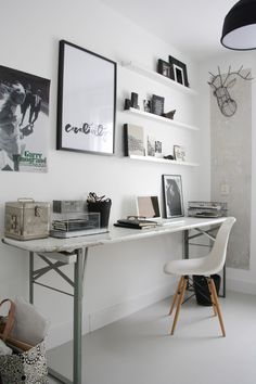 Great home office space with an Eames chair and Ylva Skarp art above the desk.