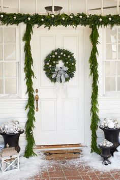 Fill large vases with white and silver bulbs to create an elegant winter wonderland theme around your front door.