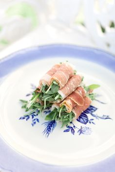 Prosciutto wrapped hors d'oeuvres were served on blue and white plates. #cocktailhour #appetizers Photography: Steve Steinhardt. Read More: http://www.insideweddings.com/weddings/parisian-inspired-bridal-shower-in-southern-california/488/
