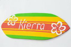 Wood Beach Sign, Surf Board Decoration, 18 inch Tropical Surfboard Wall Art with Flowers, Surfing Sign, Beach Theme Decor, Kids Surf Room. $40,00, via Etsy.
