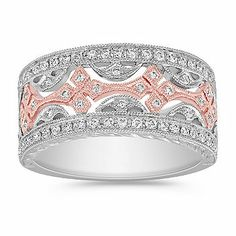 Round Diamond Anniversary Band in 14k White and Rose Gold.  This gorgeous vintage inspired anniversary band features 68 round, pave-set diamonds, at approximately .38 carat total weight.  These dazzling gems have been hand-matched for color and clarity and are set in superior quality 14 karat white and rose gold.  The milgrain detailing adds additional panche.