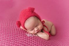 Ava R, newborn session, pink background, hands under chin pose, simple set up, newborn poses, Melzphotography, Belleville, NJ, photographer, newborn red hat