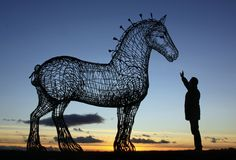 The 4.5 metre (almost 15 feet) statue of a Shire by Andrew Scott is beside the M8 motorway near Easterhouse in Glasgow is made out of galvanised steel.