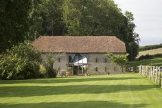 Bartholomew barn wedding venue in Sussex is ideal for a boho wedding. Image by rupertwatts.com | Visit wedding-venues.co.uk
