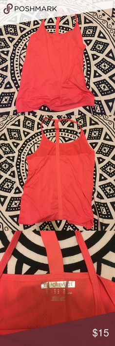 Forever 21 activewear Forever 21 activewear.  Bright coral, T strap back, lightweight, perforated material.  Has some spandex, some stretch.  Mint condition! Forever 21 Tops Tank Tops