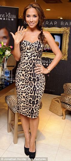 Loving the leopard-print: Myleene in a blouse at The Ivy on November 6 (left) and bandeau dress on London's Oxford Street on November 1