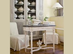 Cupboard with tureens, slip-covered chairs, table...