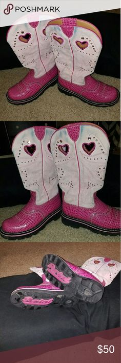 Pink Ariat Boots Super cute Ariat Boots with bling only worn a couple times as u can see no wear on bottom ...however the tops have blur wear jeans rubbed off ...not bad unless wearing with a dress Ariat Shoes Combat & Moto Boots