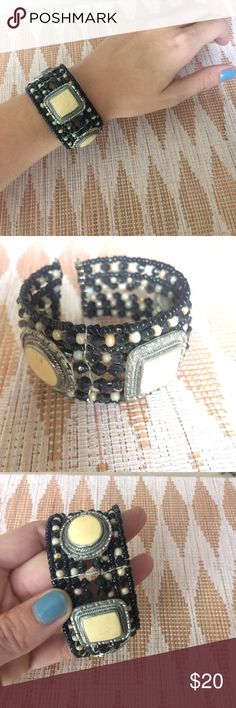 free people beaded boho eclectic bracelet cuff eclectic piece that's super versatile & unique.  free people cuff bracelet w/ rows of little black & cream beads.  3 separate large stones set in silver-like metal frame.  Open style so it's easy to slip on & off.  looks great stacked w/ other bracelets or all on its own as a statement piece.  worn a few times but in excellent condition. Free People Jewelry Bracelets