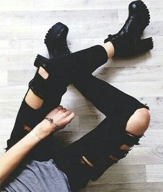 Love this outfit with the ripped jeans and black, heeled boots! So perfect.