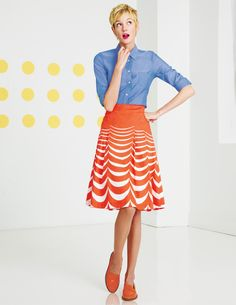 Love Love the bright orange full skirt with the blue tailored blouse!  Adorable!