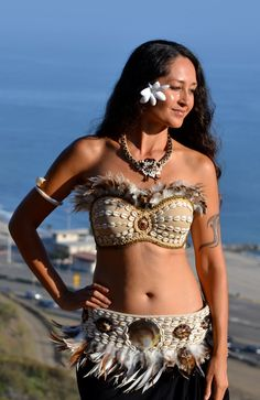 Natural cowry shell bra and matching hip belt with feathers