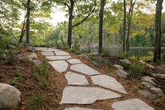 When we refer to stepping-stones in the stone industry, we generally mean pathways with stones spaced at a comfortable walking stride distance. This path along the shore of Georgian Bay was installed in the spring of 2012. What happens sometimes with a seasonal property from year to year is the overgrowth of nature. The installation of a granite step stone walk way puts and end to this and gives family and guests a safer path.