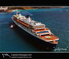 The SS Norway in Charlotte Amalie Harbor, St. Thomas. I sailed on her in 1990, 13 years before a boiler explosion took her out of service forever. What a loss.