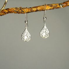 @Overstock - These cute domed filigree teardrop earrings in .925 sterling silver. This beautiful pair is hung on french hook earwires.http://www.overstock.com/Main-Street-Revolution/Jewelry-by-Dawn-Filigree-Teardrop-Sterling-Silver-Earrings/6816578/product.html?CID=214117 $12.99