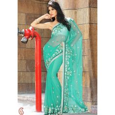 Surprise your loved ones by sending this beautiful Aqua Green Faux Chiffon Saree..........