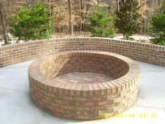 Brick Fire Pit, this would be beautiful to have this in a back yard/patio