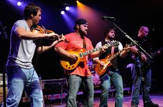 Jimmy De Martini, Zac Brown, Coy Bowles, and John Driskell Hopkins of the Zac Brown Band perform as part of Day One of the 2009 Bonnaroo Music and Arts Festival on June 11, 2009 in Manchester, Tennessee.