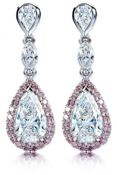 White Pear Shaped Diamonds Surrounded In Pink Brilliant Cut Diamonds & Flanked With White Diamonds Make These Drop Earrings Stunning!