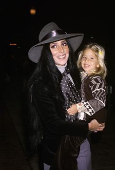 Cher and Chastity Bono 1970s. Another beautiful dark haired Mom holding her blonde daughter.