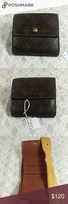 Authentic Louis Vuitton Monogram Ellise Wallet The leather showed wearing inside the wallet. The wallet was made in France with a date code TH 0941. Canvas sbowed wearing on the corners. The dimension is 4, 4 and 1. Louis Vuitton Accessories