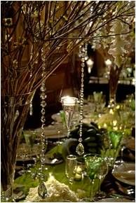 I love using branches within your forest theme table centers its a chance to hang anything you like from crystals to butterflies bringing your table to life.