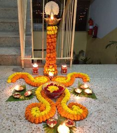 Last Trending Get all images home flower decoration ideas Viral f a e fc b bb a dfa Rangoli Designs Flower, Colorful Rangoli Designs, Rangoli Designs Diwali, Flower Rangoli, Flower Designs, Rangoli With Flowers, Small Rangoli, Diya Decoration Ideas, Diwali Decorations At Home