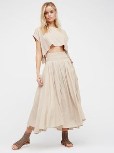 Sundown Skirt Set | In a cotton-blend this skirt set features a boxy crop top with open sides and adjustable ties. Midi wrap skirt with pleat detailing, hip pockets, and adjustable tie belt.