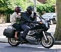 HUGH LAURIE & WIFE.motorbike, coffee, paparazzi picture, leather, helmets.www.capitalpictures.com.sales@capitalpictures.com.© Capital Pictures