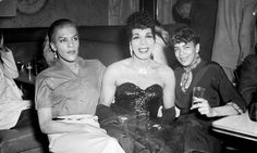 """Another side of the Hill: """"Three cross dressers in a bar, one in full evening dress with sequined bodice"""" (ca. 1959)"""