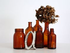 """A wonderful mix of 6 antique and vintage amber apothecary glass bottles in various sizes. """"The traces of the past"""" make this collection special and charming. It is certainly eye-catching and beautiful decoration for your home.     Assorted sizes range from 18 x 7 cm down to 12 x 5 cm    Thank you for visiting!"""