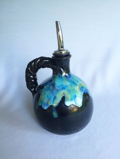Linda Neubauer - olive oil bottle - Obsidian X 2, Blue Rutile, Textured Turquoise, and Seaweed drizzled