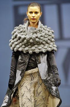 Giant bulky bobble cowl/cape over outerwear.