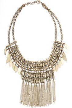 Bronze Beaded Fringe Necklace |Jewelry| This bronze gold, beaded and fringe necklace features leaf like tassles. Every boho style wardrobe needs this beauty! // www.bohme.com //