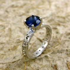 Natural Blue Sapphire 14K White Gold Swirly Engagement Ring with Diamond Accent Stones.via Etsy.