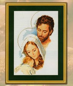 Baby Jesus with Mary and Joseph  (in cross-stitch)