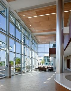 The entrance two-story glass lobby includes seating areas, local artwork, and a materials palette reflective of the region. Photo: Jim Roof Photography