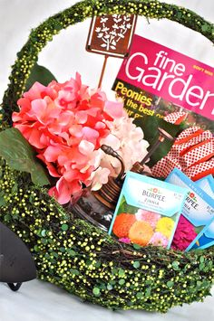 First up is this gorgeous basket for the Mom that loves to garden.  We used a fabulous, green vine basket from Pottery Barn to contain our gardening goodies. Items included a gardening magazine, seed packets, tools, gloves, a mister and a lovely hydrangea plant.