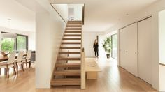 Quebec firm Atelier Pierre Thibault has overhauled a home built in the 1970s, removing interior partitions and locating a sculptural plywood staircase at its core.