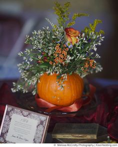 a pretty pumpkin centerpiece for a colorful diy wedding in the fall