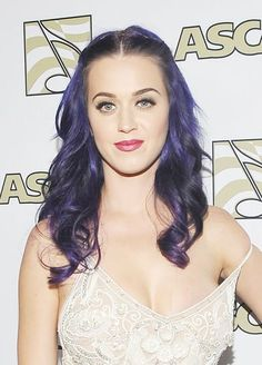 Katy Perry nearly makes a wardrobe malfunction of herself after her dress slips down at the 29th Annual ASCAP Pop Music Awards in Hollywood