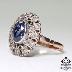 Period: Edwardian (1901-1920) Composition: 18K gold and platinum. Stones: 12 Single cut diamonds of H-SI2 that weigh 0.30ctw. 1 natural oval cut sapphire that w
