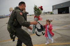 U.S. Navy Lt. David Jarrett greets his daughter during a homecoming celebration at Naval Station Mayport, Florida on March 17, 2010.