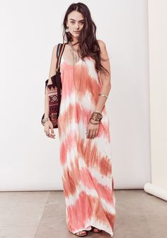 Effortless, sleeveless, tie-dye maxi dress featuring a deep v-neck, gathered cocoon like fit, side pockets and adjustable straps. Variations may occur due to our unique, hand-dyed process. Each dress
