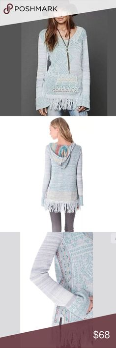 """New Free People Dream Time Story Tunic Sweater A fringed hemline and draped hood lend a bohemian feel to this dreamy loose-knit tunic by Free People. Long sleeves flare subtly, and a front pocket lends a cozy touch. NWOT Measures approximately 17 1/2"""" across under arms, 17"""" waist, 28"""" sleeves, 32"""" length. Please note size tag is cut through but it is an x-small.  Fabric: Loose knit. 90% cotton/10% acrylic. Hand wash. Imported, China Tags cut in store to prevent retail store returns. Free…"""