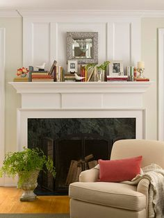 Modern Interior Design with a beige sofa and cushions and a heating stove and a pot plants and ornaments and a small mirror and paint the walls white Mantel Decorating Ideas